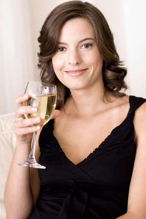 A young woman with a glass of white wine photo