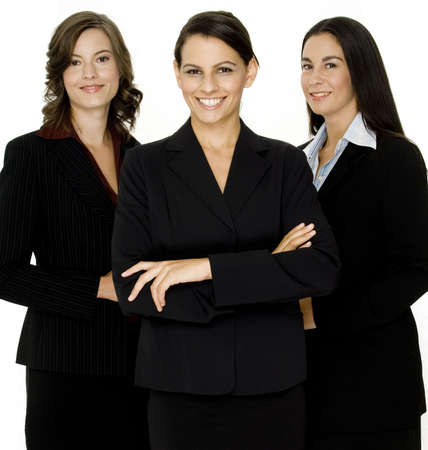 A young business team of three professional women in business suits on white background