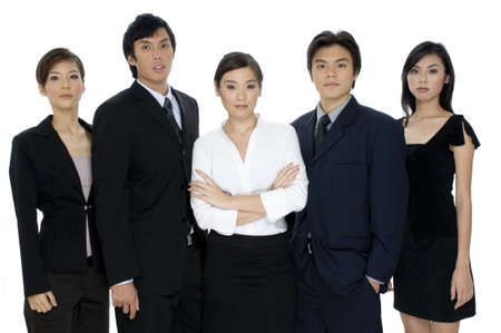 A confident business team of young asian professionals on white background photo