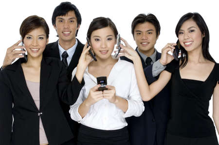 A group of young business people swapping telephone calls on white background photo