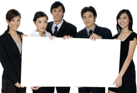 A group of asian businesswomen and men holding a large blank sign on white background
