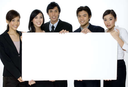 asian office lady: Five young professionals holding a large blank sign