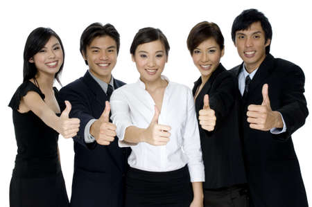 thumbs up business: A business team giving the thumbs up on white background