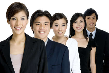 A group of young asian businessmen and women on white background (focus is on middle person) photo