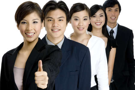A group leader gives the thumbs up for her business team photo