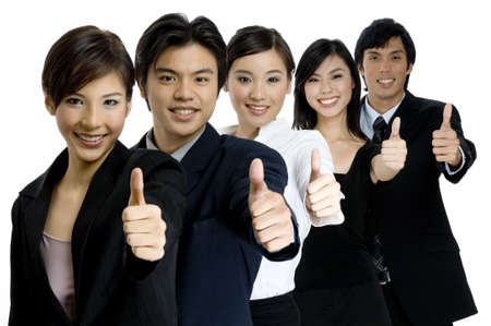 A young successful asian business team gives the thumbs up on white background photo