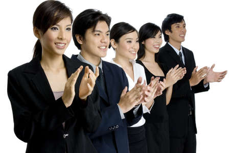 A young asian group of business people in a line applauding