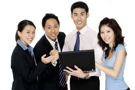 Four young asian businessmen and women with a laptop computer