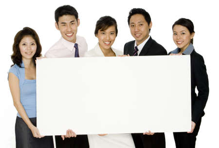 An asian business team holding a large blank sign on white background Stock Photo