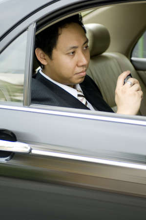 driven: A young asian businessman being driven to work