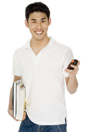A young asian man in white shirt holding books and a mobile phone photo