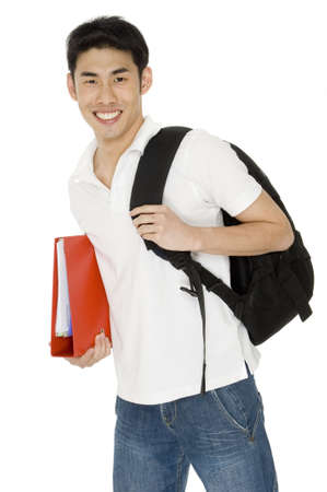 A young asian student with ring binder and backpack on white background photo
