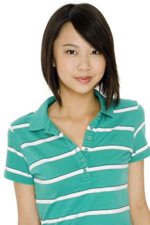 An attractive asian teenage girl in green polo shirt on white background Stock Photo