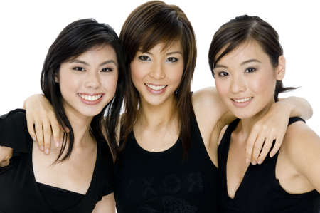 Three attactive asian women in black tops on white background photo