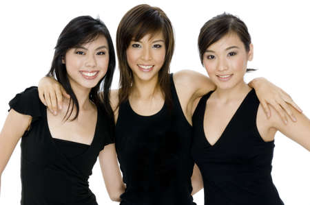 Three attractive young women wearing black tops on white background Stock Photo