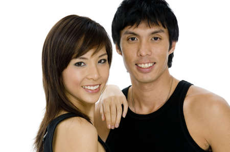 bloke: Two good-looking young asian adults in black on white background