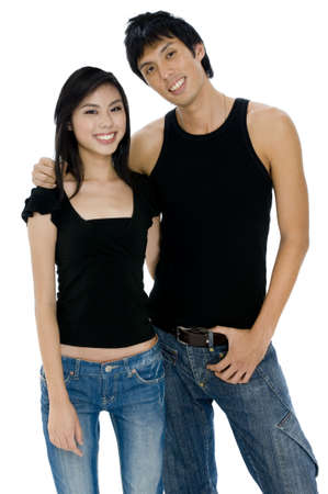 bloke: Two young asian adults in black tops and jeans on white background