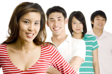 Four good-looking asian men and women standing in a row (shallow depth of field used) Stock Photo