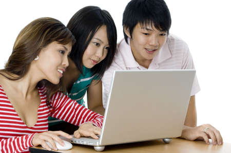 causal: Three young asian adults working on a laptop computer
