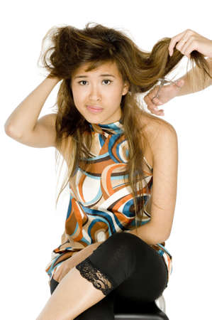 troublesome: A young asian woman has her troublesome hair cut Stock Photo