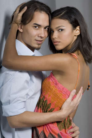 sensuous: Two attractive young adults in a sensuous pose (shot inside against a wall)
