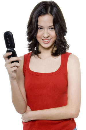 flip phone: A pretty young teenager holding a flip phone on white background