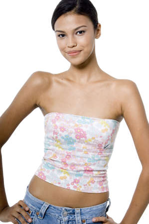 A young attractive asian woman in a flower print tube top on white background photo