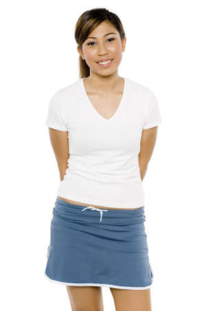 tennis skirt: A young athletic woman in white t-shirt and blue tennis skirt on white background