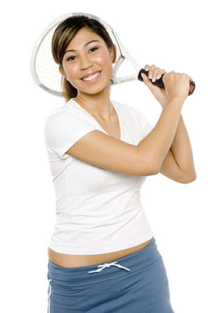 A young pretty asian woman swinging a tennis racket on white background Stock Photo - 947156