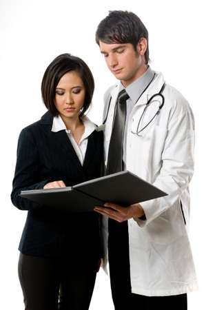 young male doctor: A young male doctor with female colleague on white background