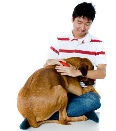 big shirt: A young chinese man with his big pet dog