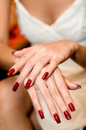 A young woman shows her newly painted nails