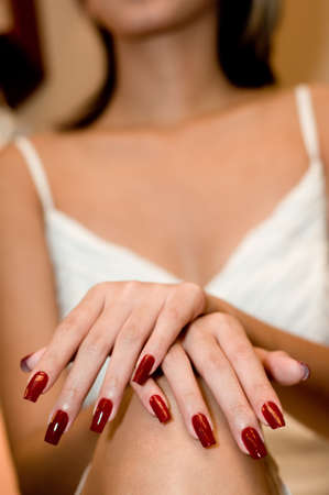 beautification: A young woman shows off her new manicured nails