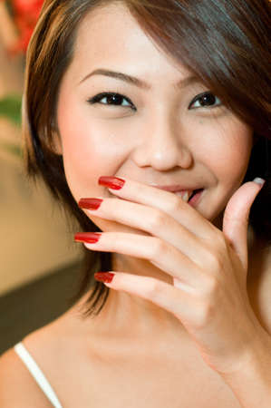 beautification: A young attractive Asian woman with freshly manicured hands Stock Photo