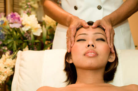 beautification: A young Asian woman has a head massage