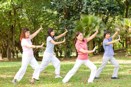 friendship women: A group of asian ladies exercising in the park