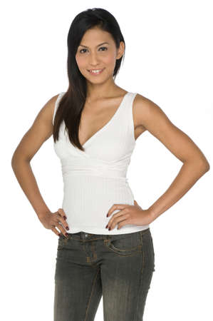 A slim and pretty Asian woman in white top and jeans posing in studio on white background Stock Photo - 1693473