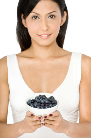 A pretty young Asian woman holding a bowl of blueberries on white background Stock Photo - 1693528