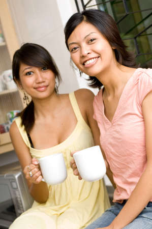 frienship: Two women with a mug of coffee or tea Stock Photo