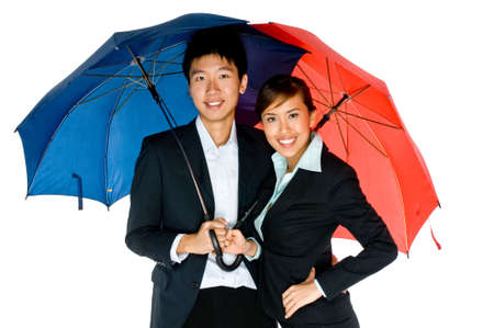 A young Asian couple in business attire with umbrella on white background