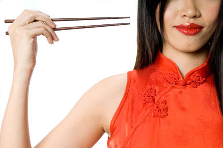 A model in traditional dress holding chopsticks