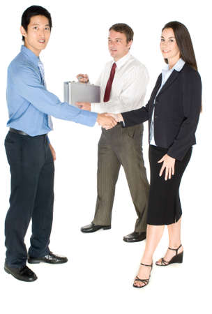 business transaction: A group of business people meeting together for business transaction on white background