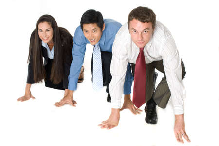 crouched: Three businessmen and woman crouched down ready to start a race