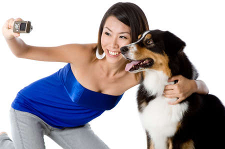 A young woman takes a photo with her pet dog Stock Photo - 2487579
