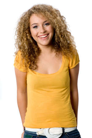 A happy teenage girl with curly hair on white background Stock Photo