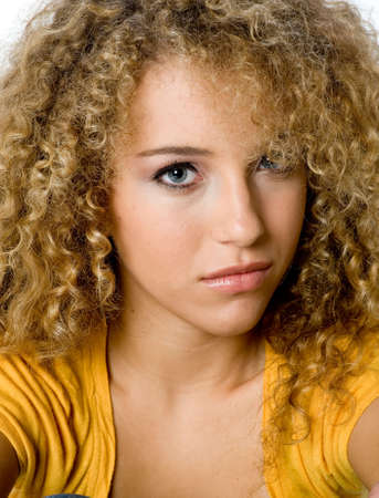 A pretty young woman with great curly hair on white background photo