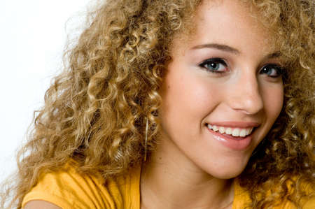A pretty young woman with great curly hair on white background