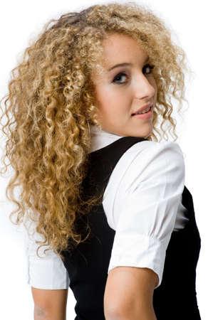 Une jolie adolescente avec beaucoup de cheveux sur fond blanc  Banque d'images