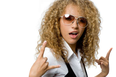 A cool young woman with great hair wearing sunglasses photo