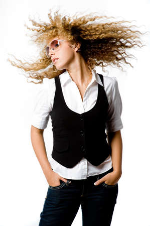 A young woman with great hair making it fly photo
